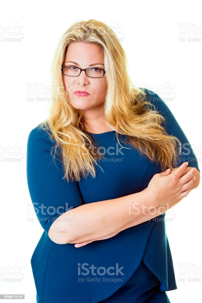 Savvy business woman stares intensely at camera. stock photo
