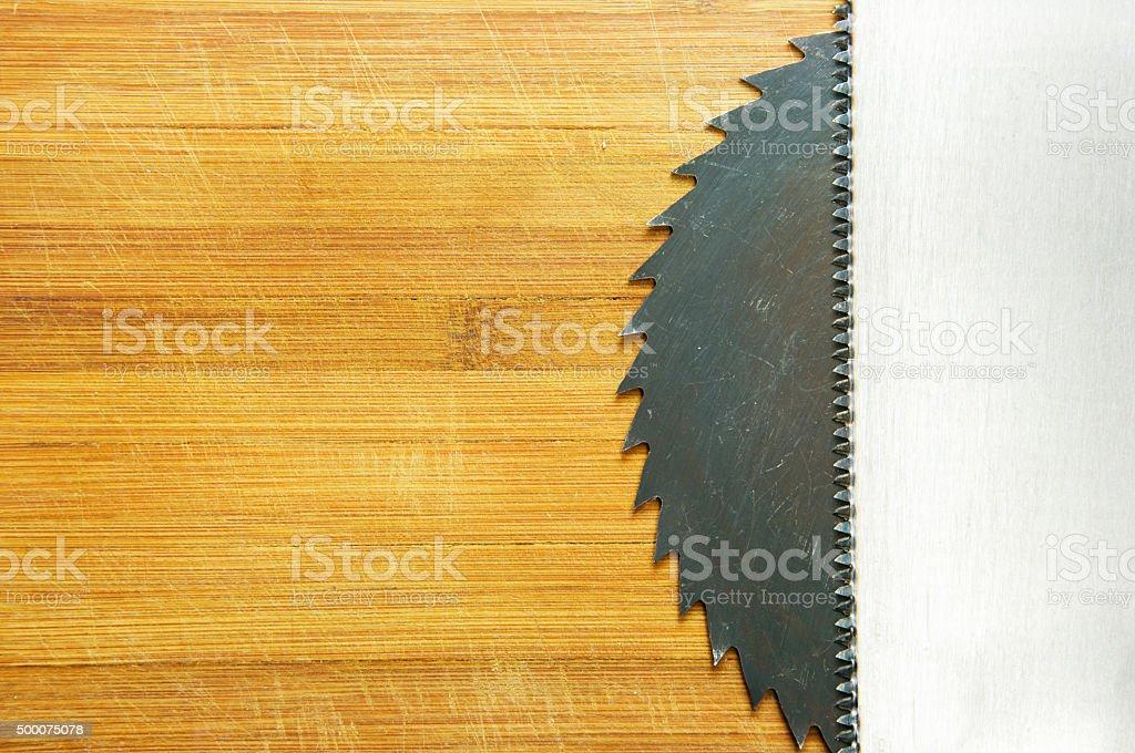 saw blade and wood saw stock photo