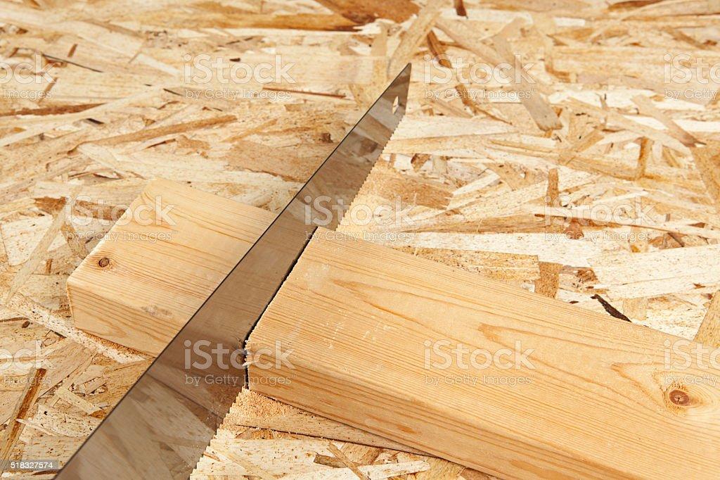Saw Blade Cutting a Board stock photo