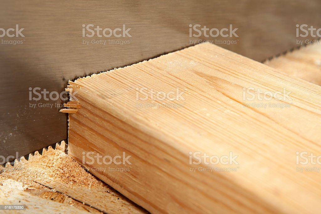 Saw Blade Cutting Through a Board stock photo