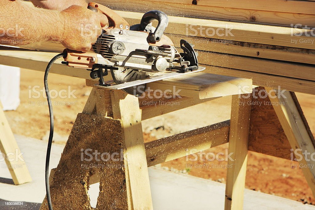 Saw Cutting Construction Lumber Plank royalty-free stock photo