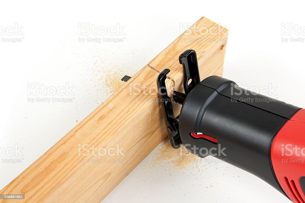 Saw Cutting Through Wood stock photo