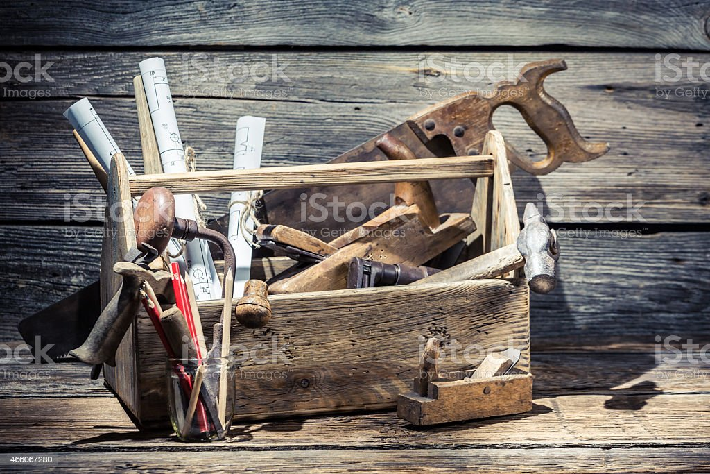 Saw, hammer and planer in the carpentry toolbox stock photo