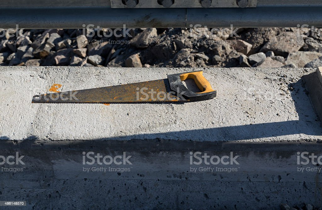 Saw on the concrete royalty-free stock photo