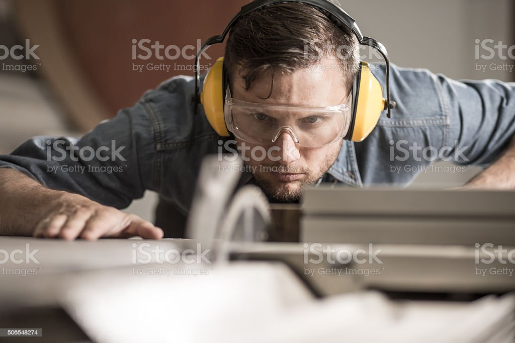 Saw operator preparing ideal board stock photo