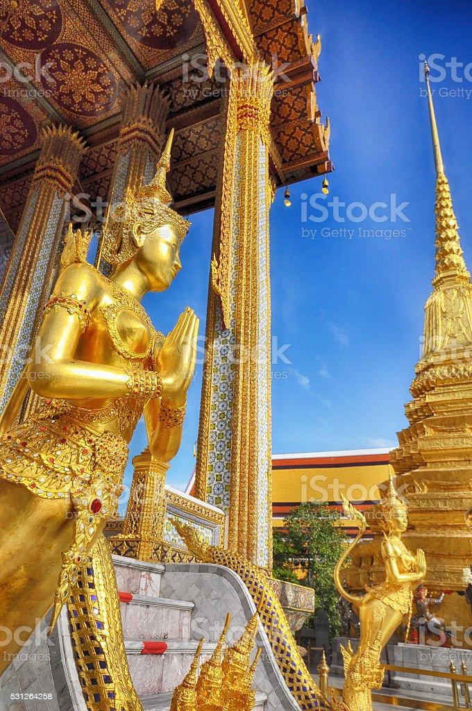 Sawasdee, golden statue of Kinara at Wat Phra Kaew, Thailand stock photo