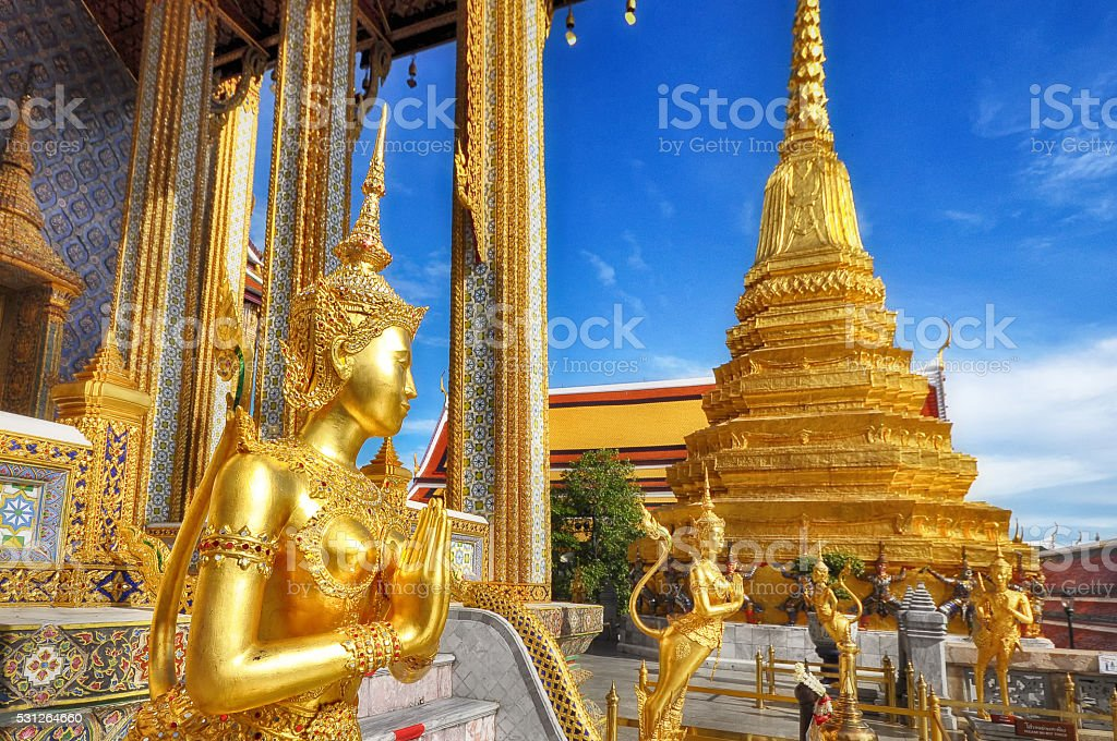 Sawasdee, golden statue of Kinara at Wat Phra Kaew, Thailand stock photo