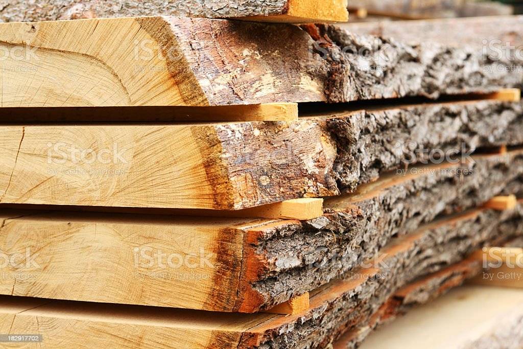 Sawed oak tree trunk plank being dried stock photo