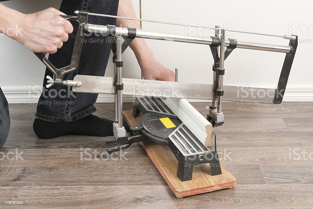 Sawing Baseboard royalty-free stock photo