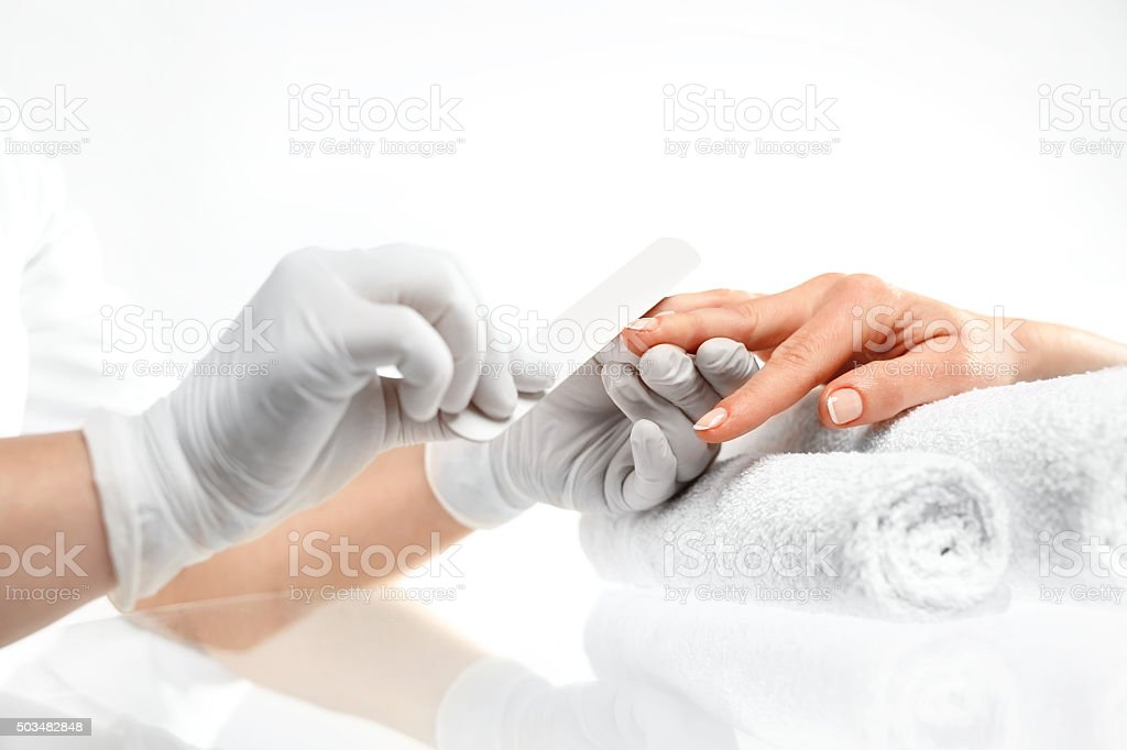 Sawing nails, manicure . stock photo