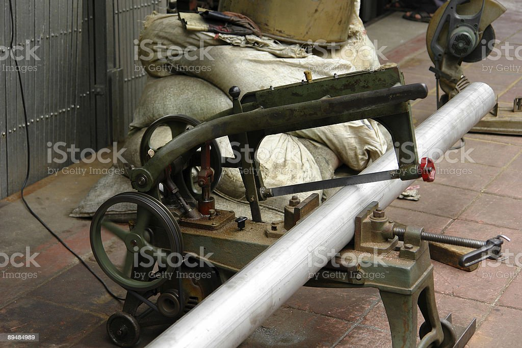 Sawing pipe royalty-free stock photo