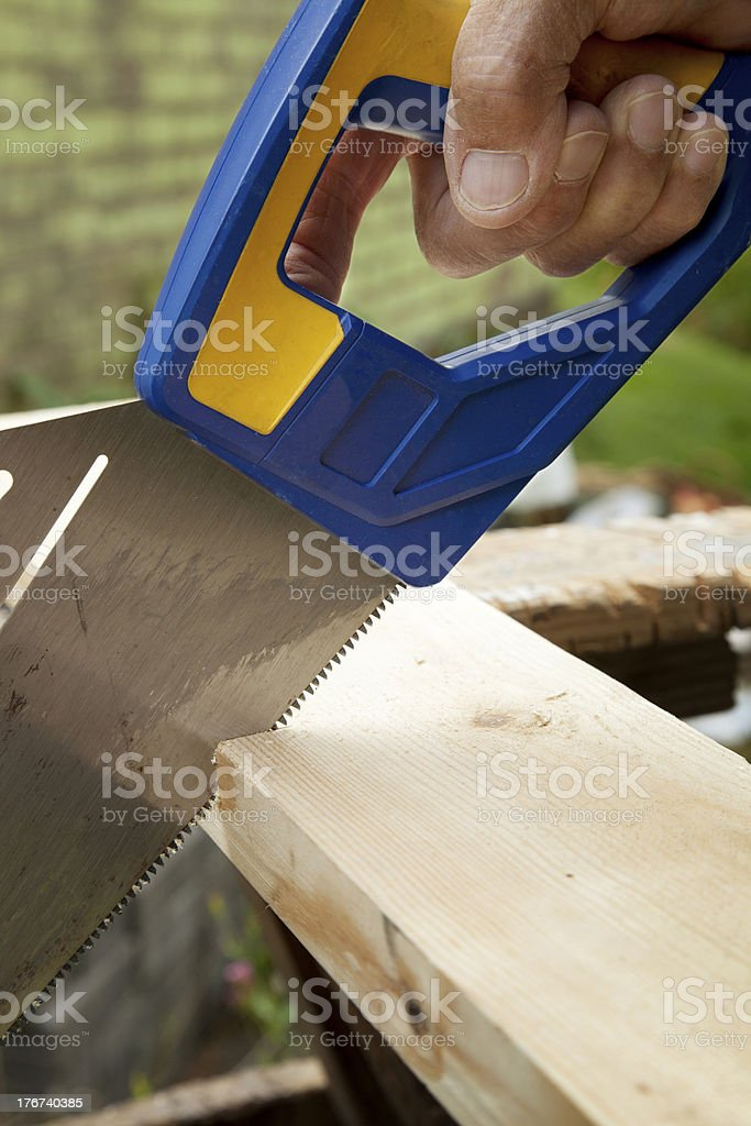 Sawing through wood royalty-free stock photo