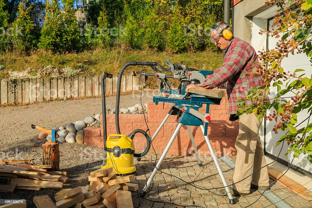 sawing with a smile stock photo