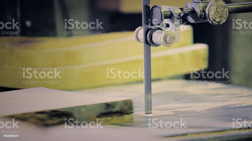 Sawing wood stock photo