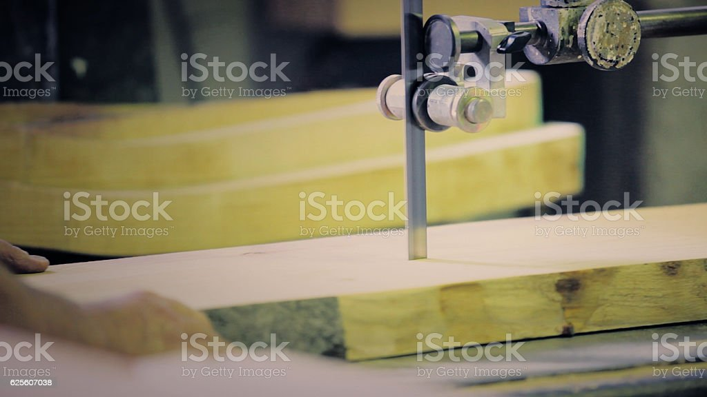 Sawing wood stock photo