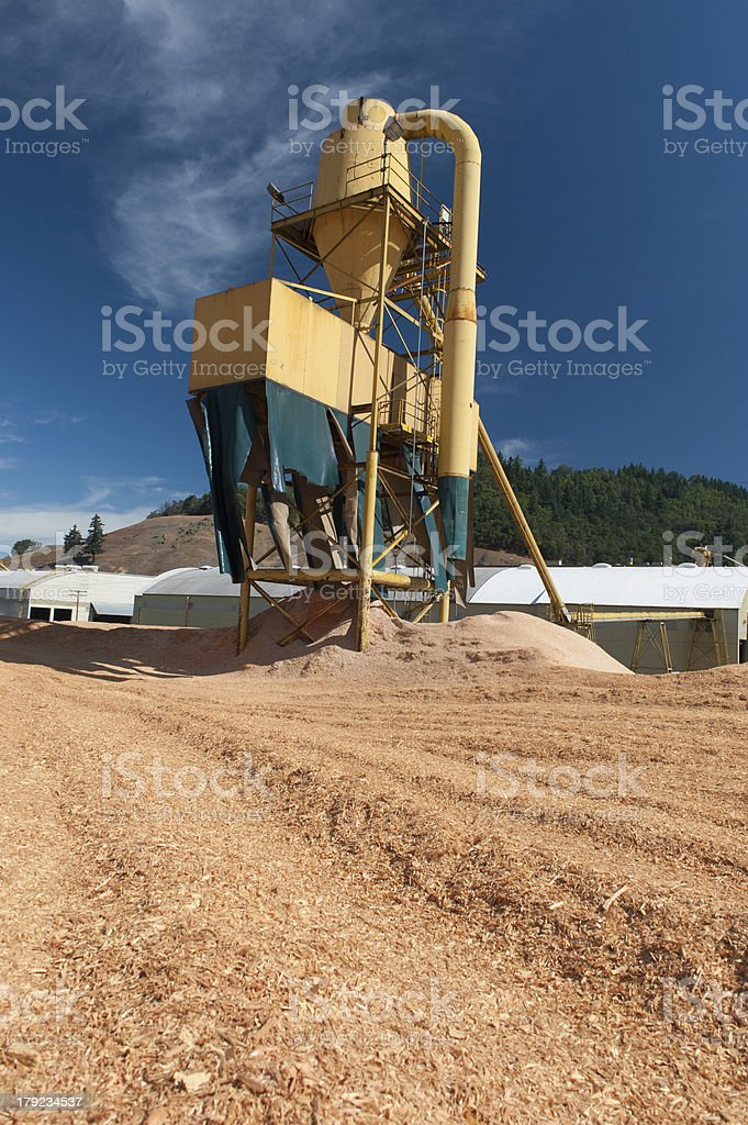 Sawmill plant machine with sawdust everywhere royalty-free stock photo