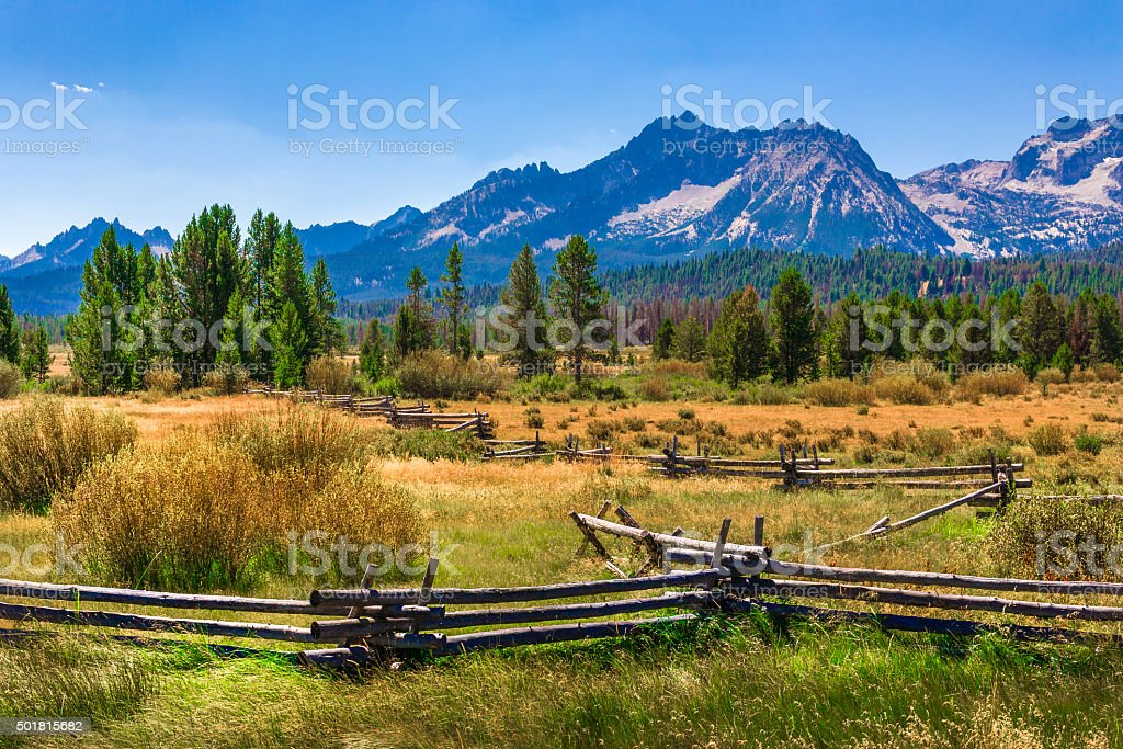 Sawtooth Mountains, ranch land, rail fence, Stanley, Idaho (ID) stock photo