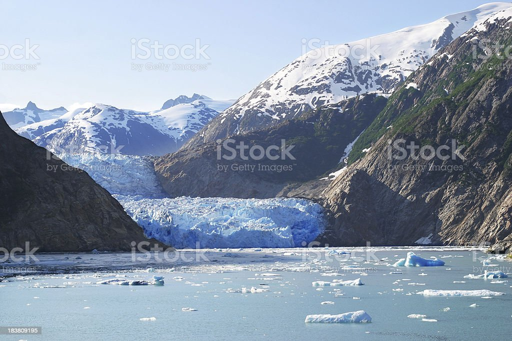 Sawyer glacier in Alaska mountains stock photo