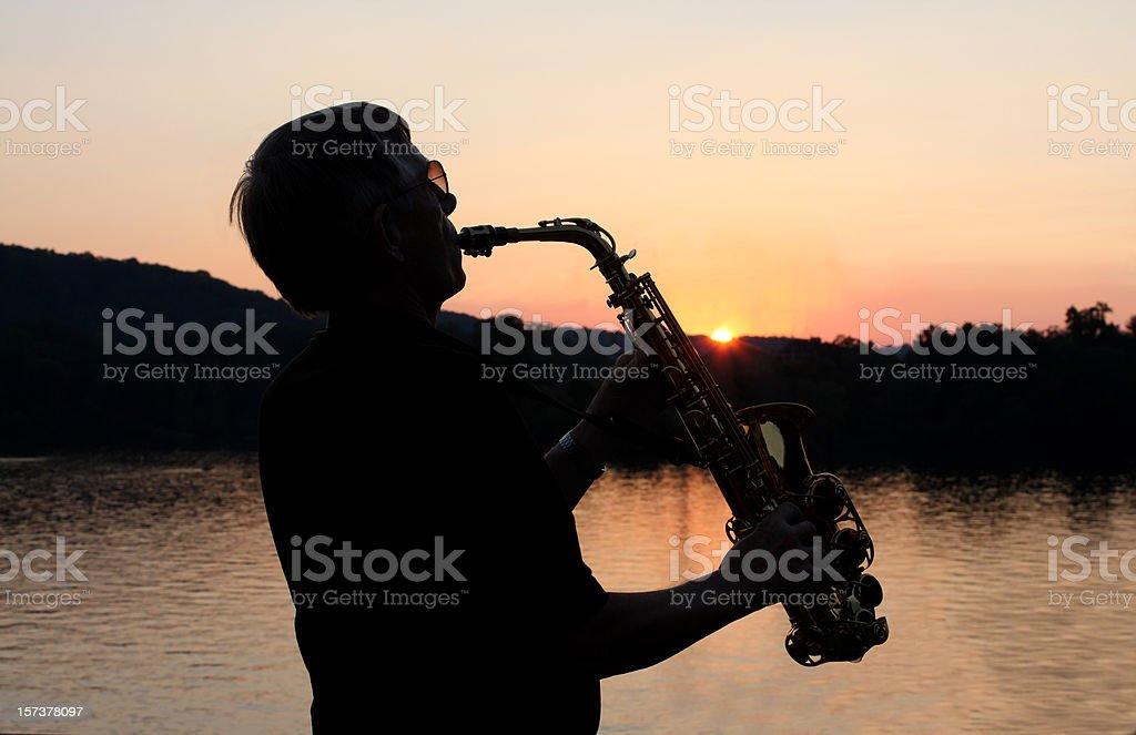 Sax Man Silhouette at Sunset stock photo