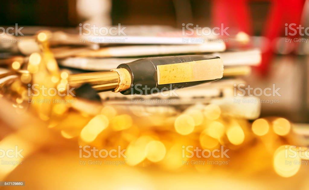 Sax mouthpiece on gold stock photo