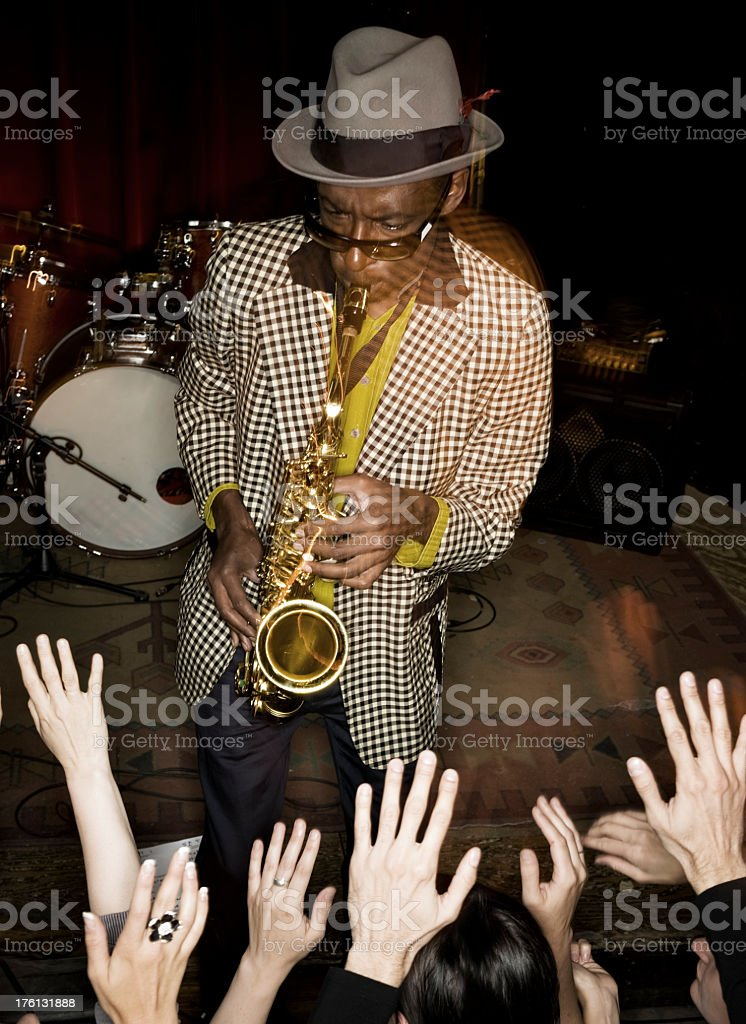 Sax Player with a crowd stock photo