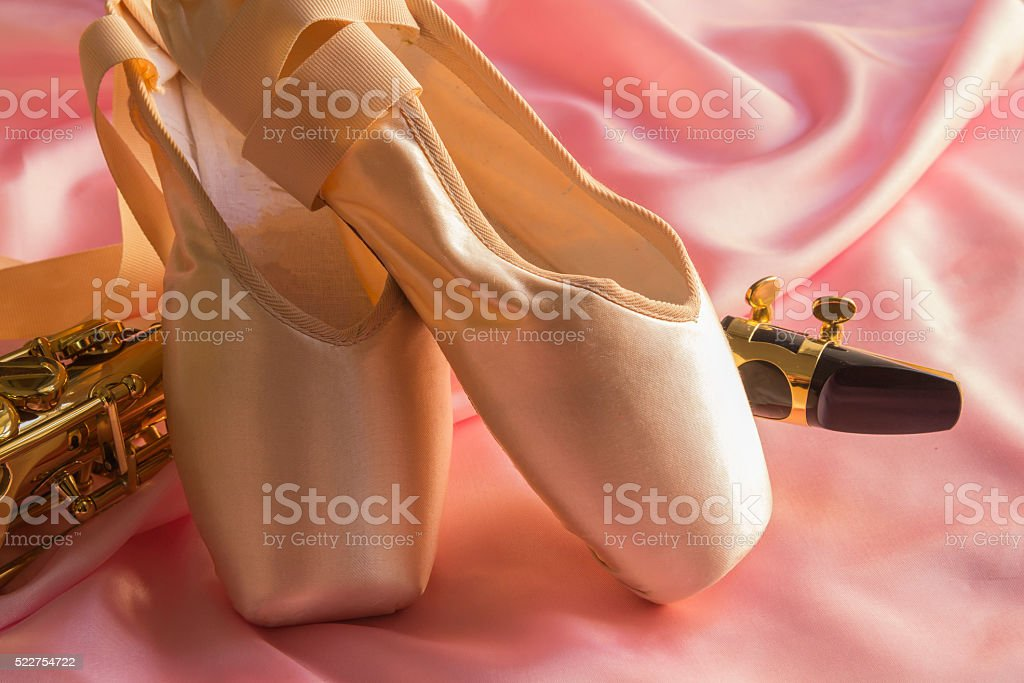 Saxophone and Ballet shoes stock photo