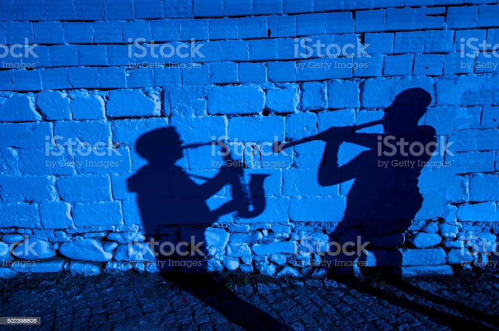 Saxophone and clarinet shadow. stock photo