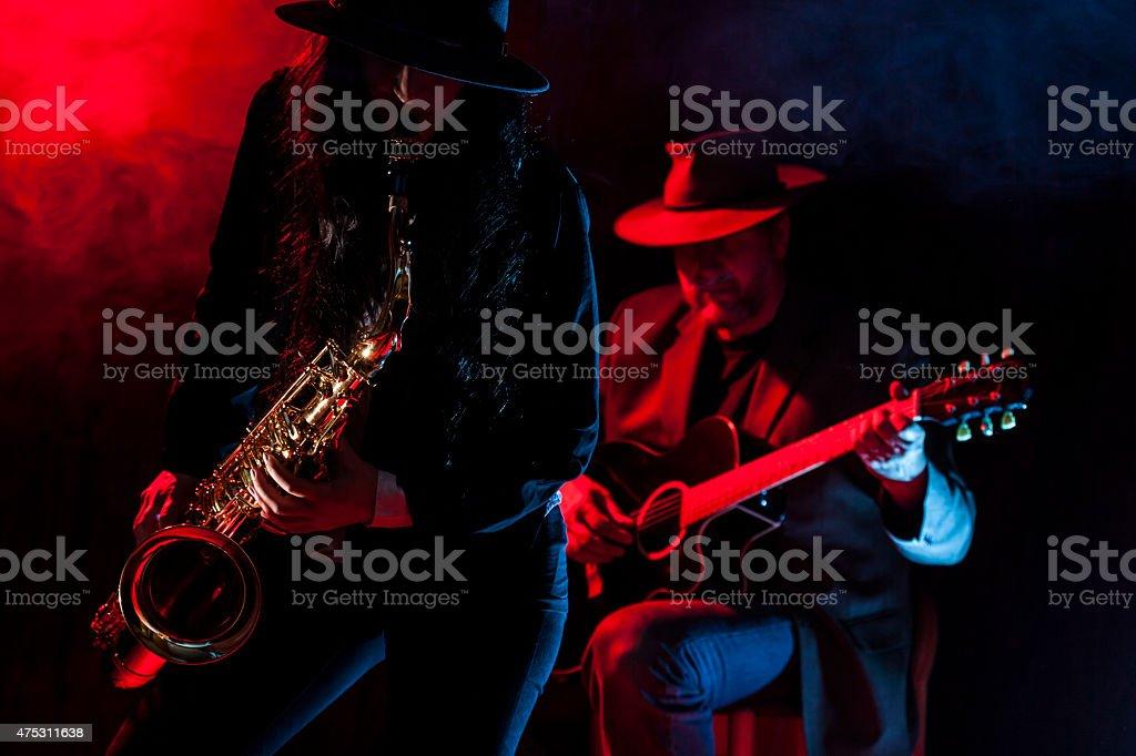 Saxophone and Guitar stock photo