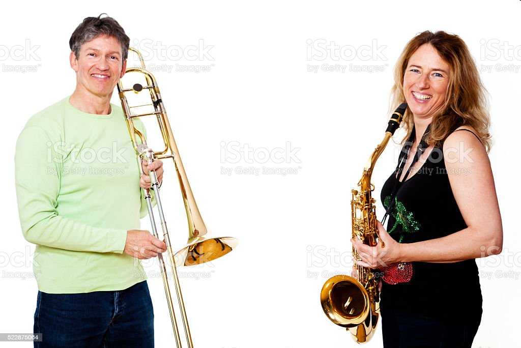 saxophone and trombone player stock photo