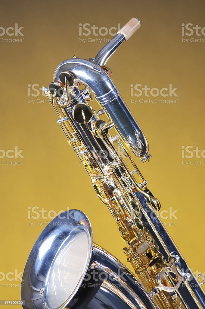 Saxophone Baritone Isolated on Yellow stock photo
