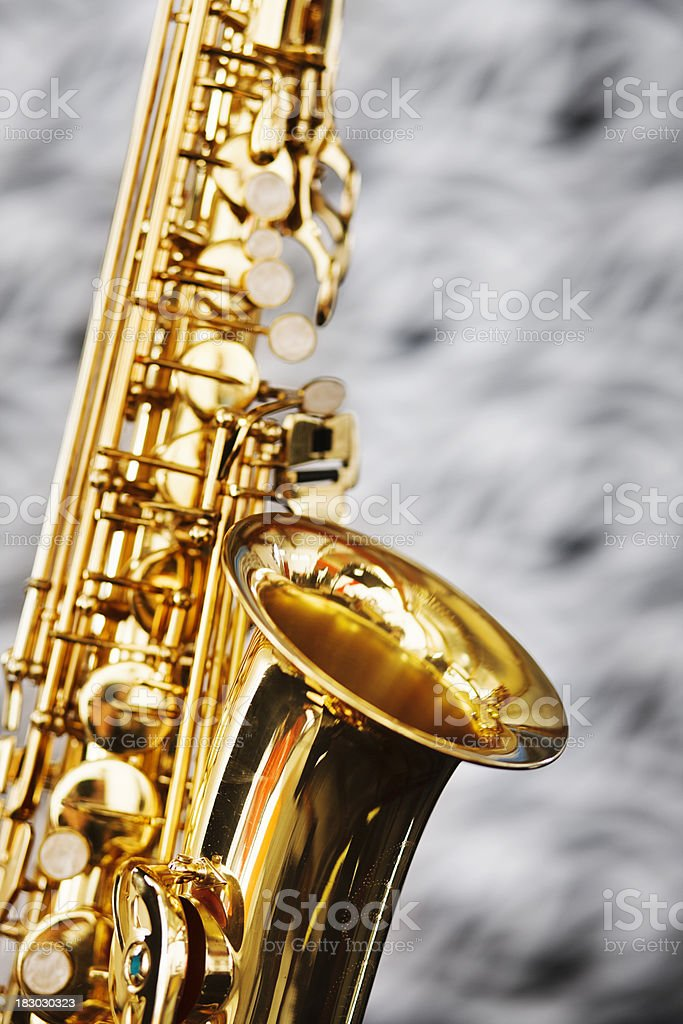 Saxophone in close up against out of focus textile stock photo