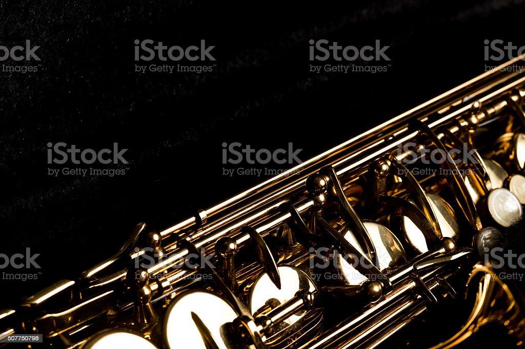 Saxophone in the black box stock photo