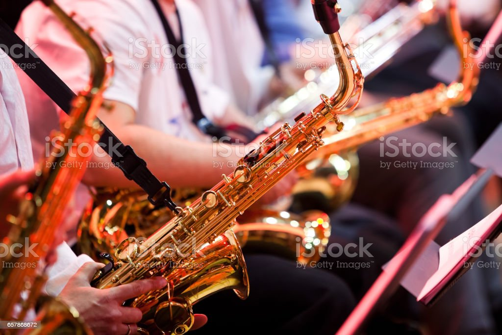 Saxophone in the hands of a musician stock photo