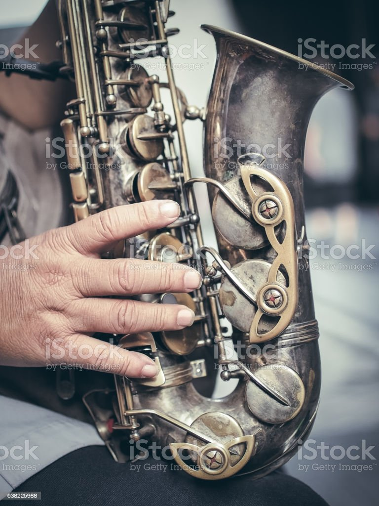 Saxophone in the hands stock photo