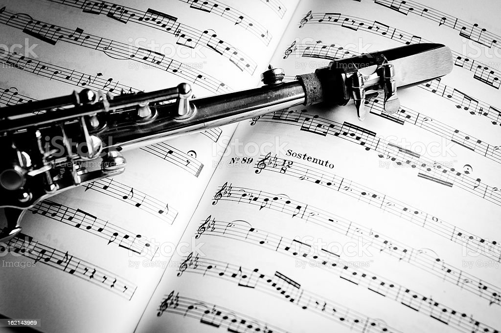 Saxophone on music sheets, black and white stock photo
