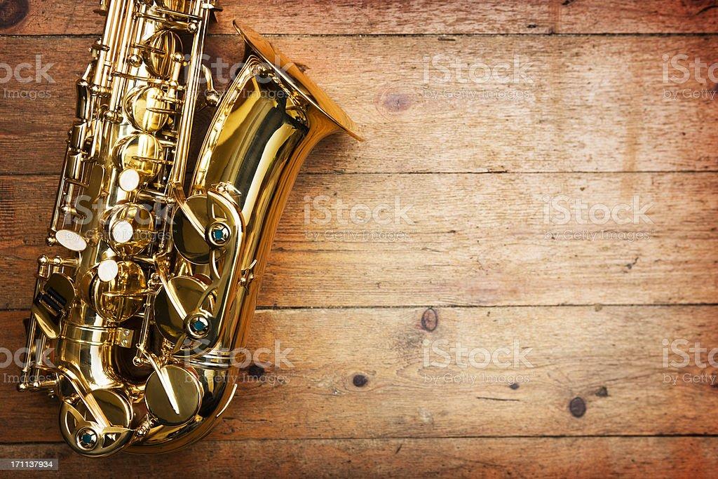 Saxophone on wood stock photo