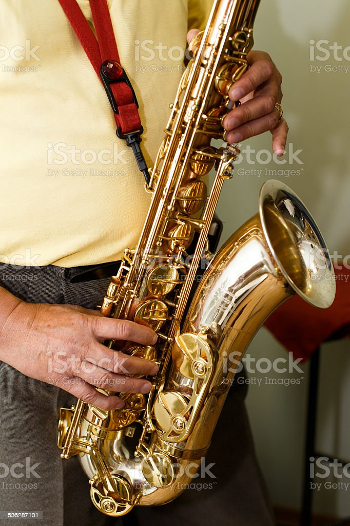 Saxophone player in action stock photo