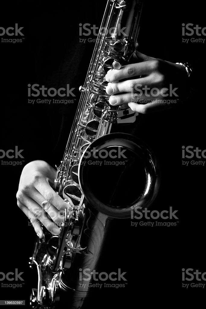 A saxophone player in black and white royalty-free stock photo