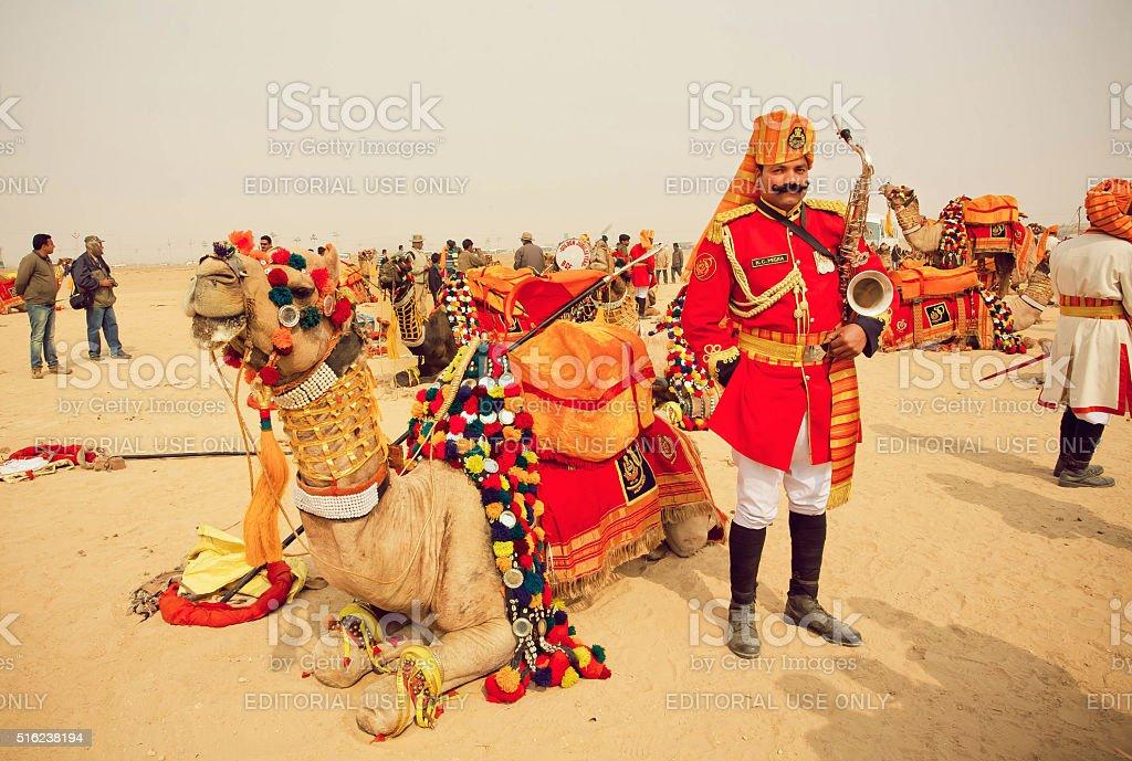Saxophone player in uniform on Desert Festival stock photo