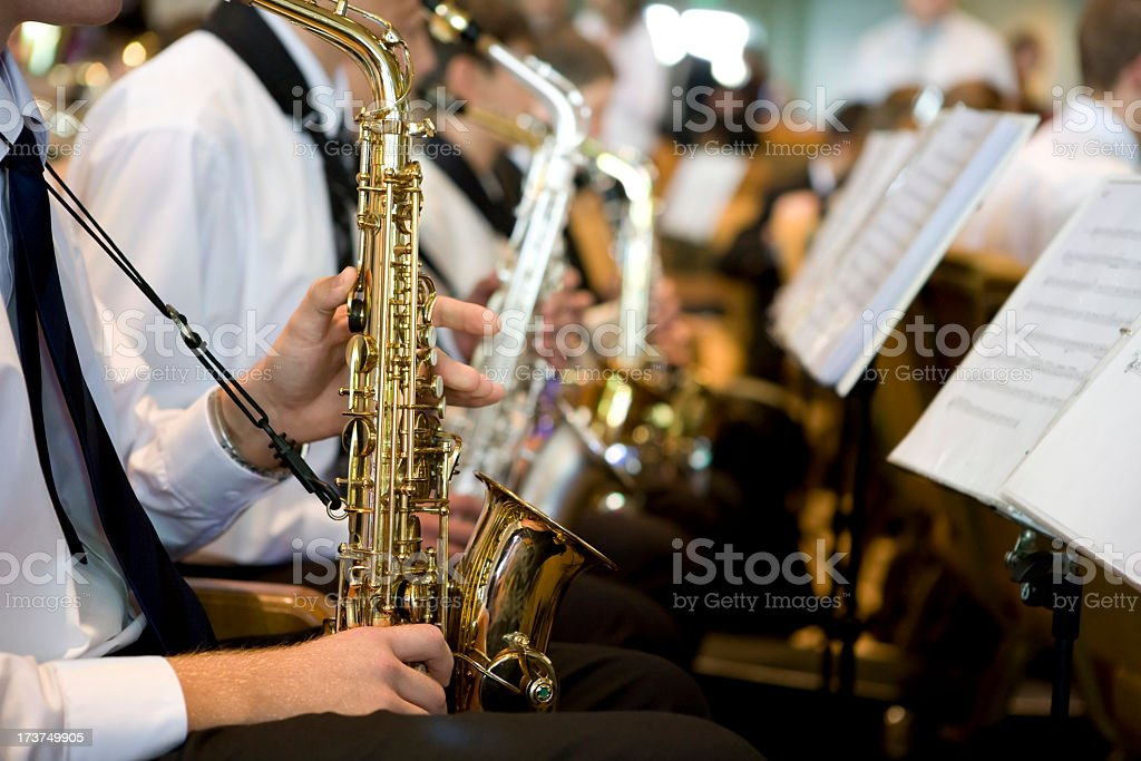 Saxophone player performing on orchestra stock photo