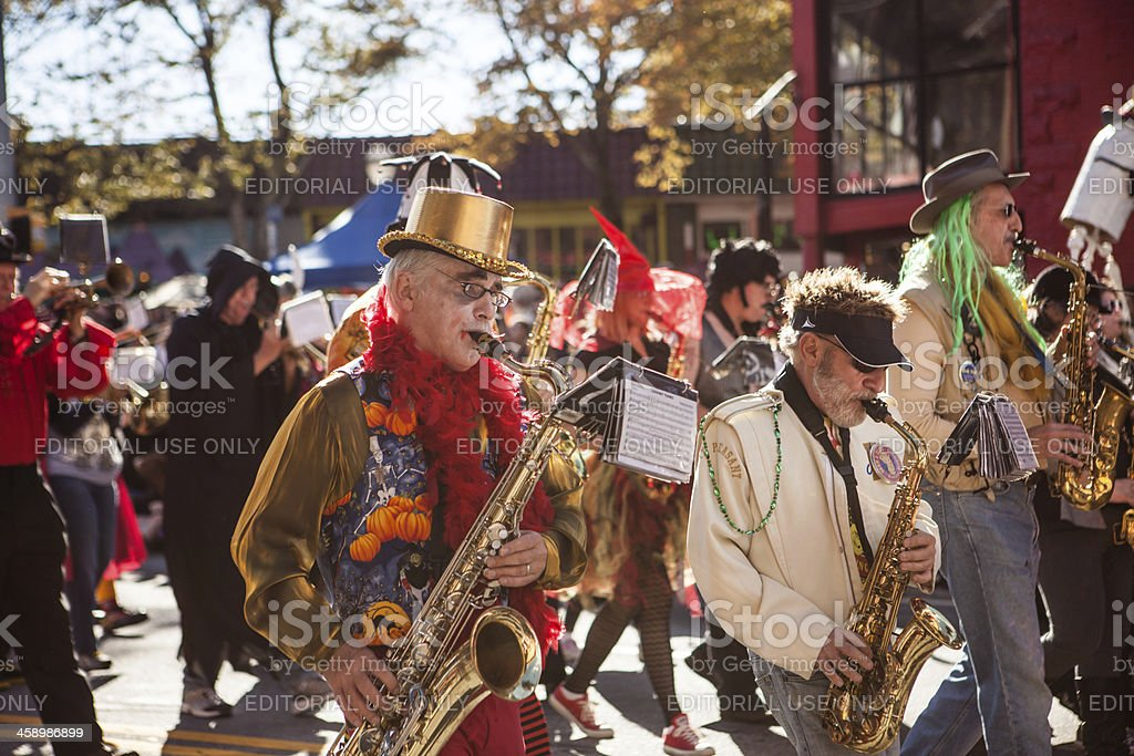 saxophone players march with their band stock photo