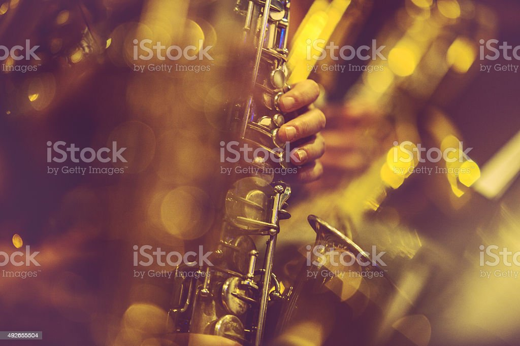 Saxophone Players playing live music stock photo