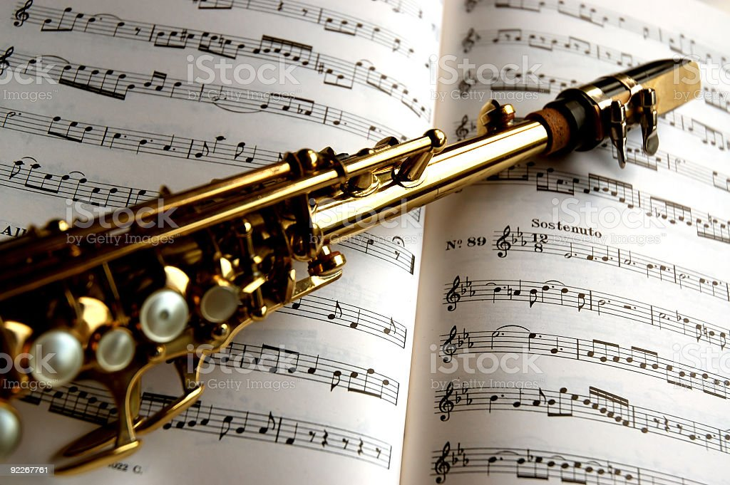 Saxophone soprano on music sheets stock photo