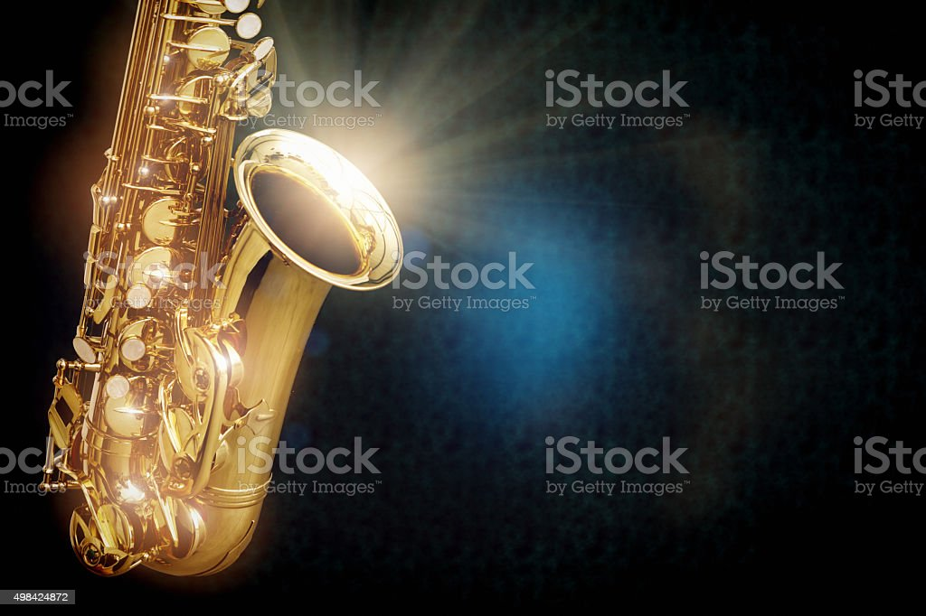 Saxophone with burst of diffused light on dark background stock photo