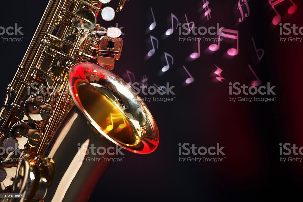 Saxophone with musical notes stock photo
