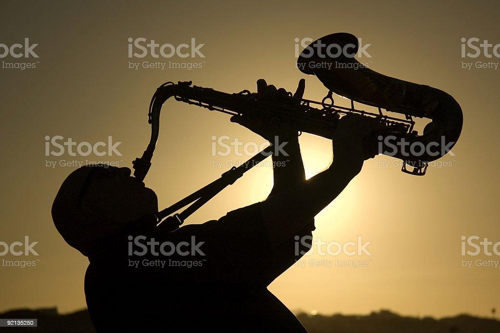 saxophonist at dusk 2 stock photo