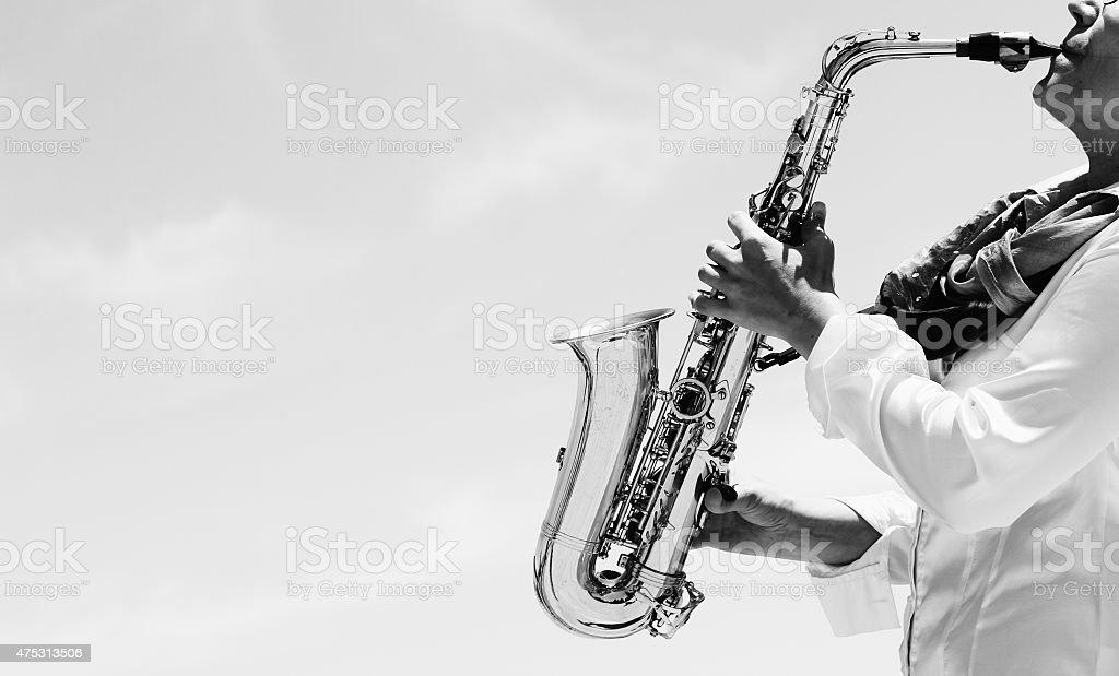 Saxophonist playing on saxophone stock photo