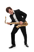 Saxophonist playing saxophone hard rock with a funny face.