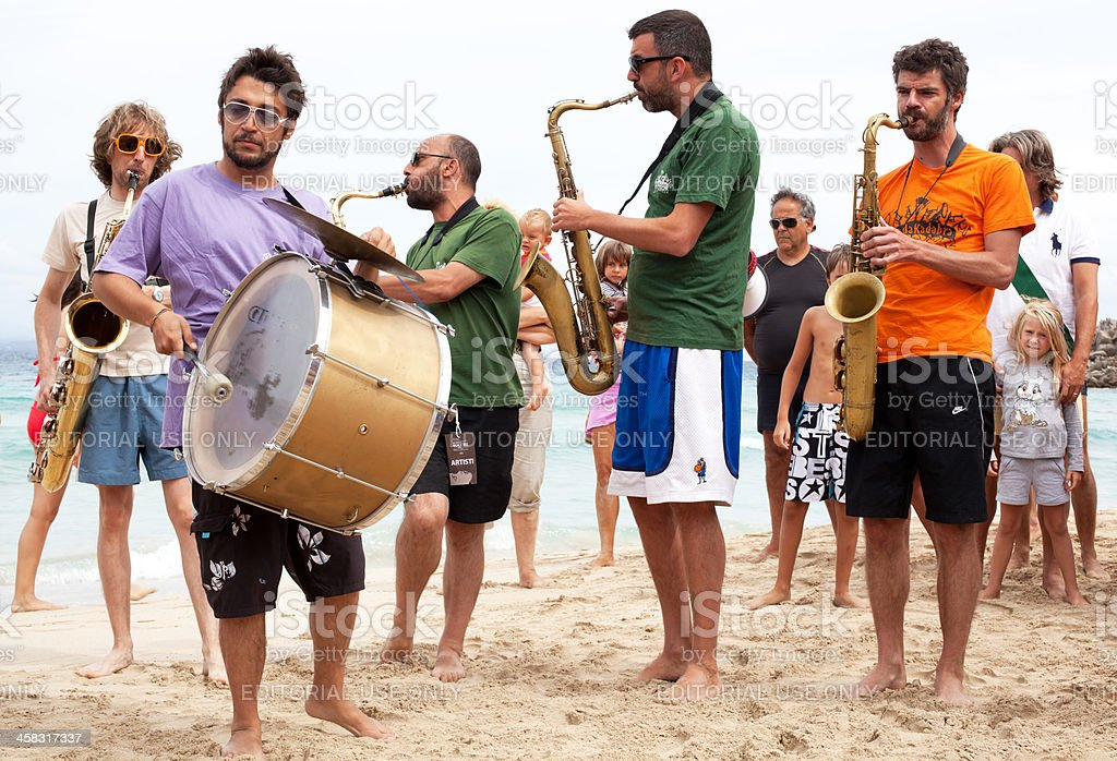 Saxophonists and Drummer playing on the Beach stock photo