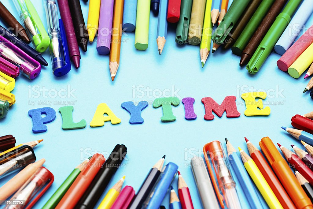 PLAYTIME say colour capital letters with lots of drawing materials! royalty-free stock photo